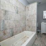 Bathroom In House Bathtub Toilet Lavatory And Mirror