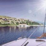 hera bay luxury resort seen from sailing yacht settlement on hill in hera bay samos island