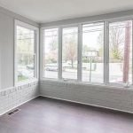 Living Room Fronting Street Home For Sale In America Large Windows Lots of Natural Light