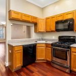 Spacious Wooden Kitchen With Big Cooker Microwave Oven Dishwasher And Powerful Extraction