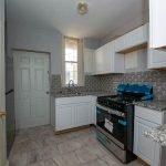 Well-equipped Kitchen with Large Cooker Oven Microwave Fridge and Freezer