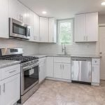 Well-equipped Kitchen With Stove Oven Microwave Combination Fridge And Freezer And Dishwasher